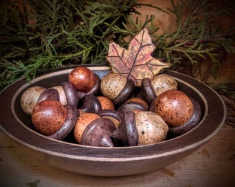 Carved wooden acorns with carved wooden bowl