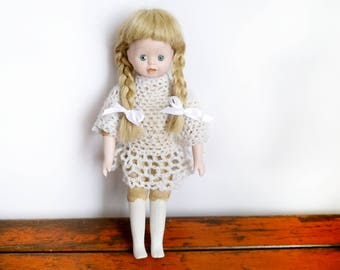 Antique Porcelain Doll Blond hair Girl Porcelain head and legs fabric body turn of the century handmade beautiful doll