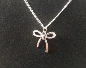 Bow pendent on silver chain
