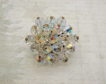 A fine 1960's / 70's period flower head vintage jewelry brooch in silvertone metal set with sparkly aurora borealis crystal faceted beads