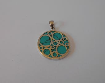 Handmade Sterling 925 silver and Torquise pendant.