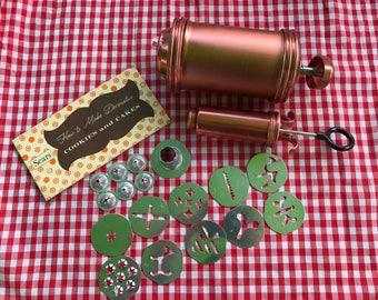 50's cake and cookie decorator set in original box/ Sears cooky press/ Sears cake decorator/ 19 piece cookie and cake decorator set