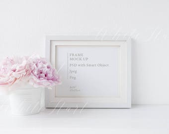 "Frame mockup - 8x10"" size and landscape orientation. Styled stock photography which includes a PSD with smart object and a Jpeg in high res"