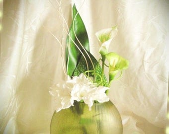 Green and white lilies composition and artificial orchids