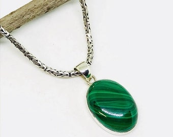 10% Malachite pendant, necklaces set in sterling silver(92.5). Natural authentic malachite stone. Length- 1.5 inch long.