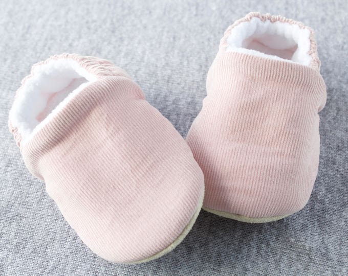 Soft Pink Corduroy  baby moccs featuring a cosy fleece lining for pre walkers and toddlers