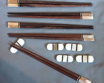 Handmade, Vietnamese Rosewood Chopsticks with Brown Abalone shell and striped accents  comes with matching oval shaped, striped rests