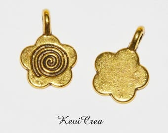 16 x swirl gold tone flower charms