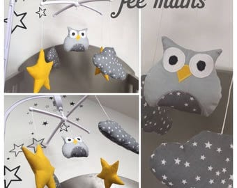 Mobile musical baby with yellow and grey owl, clouds and stars