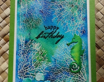 Ocean birthday card with seahorse, seaweed, and seashells