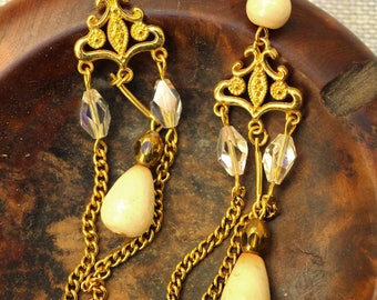 Long baroque, romantic, shabby, ivory-gold buckles. Glass drops, crystal and ceramic beads, gold plated connectors and chains.