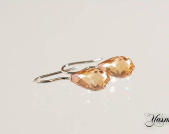 Faceted cubic zirconia drops champagne on Sterling