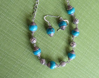 Tibetal silver and turquoise colored beads with matching earrings set