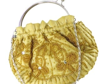 Bijoux Terner Vintage gold taffeta beaded purse in champagne gold, seed beads and sequins. Silver kiss lock closure and chain handle.