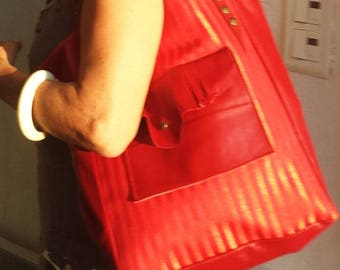 Dark red leather tote bag and red striped fabric