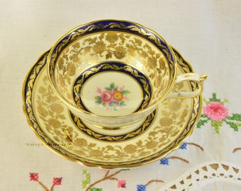 Richly gilded cobalt Paragon cup and saucer