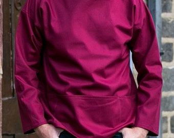 Artist's smock in maroon cotton twill, reversible so pockets can be worn either back or front, available in sizes XS to Large