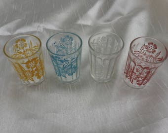 Set of 4 vintage shot glasses with printed floral design in four colours