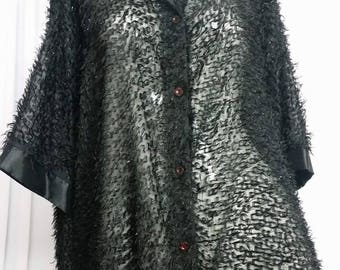 Transparent black blouse with thread hairs