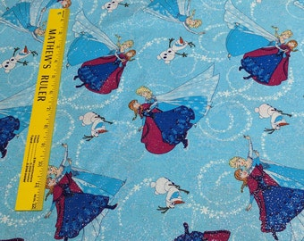 Frozen-Sisters Ice Skating Glitter Toss Cotton Fabric