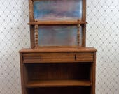 Dollhouse miniature furniture in twelfth scale or 1:12 scale.  Hand carved back bar qith mirrored back.  Item # D368.