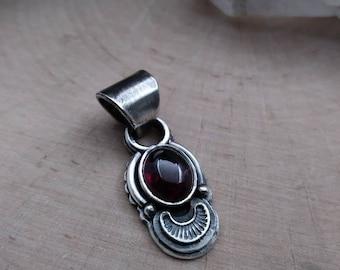 Tiny sterling silver garnet pendant