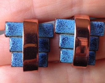 Copper and blue clip on earrings.