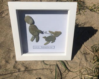 "Pebble Art - Contemporary picture using selected pebbles from the Cornish Coast. ""Love is walking the dog"" Great present for dog lovers!"
