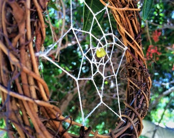 Dream Catcher made of Twigs with Peridot Stone at Web Center