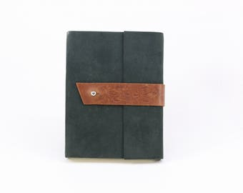 Brown buckle with irises and green leather notebook