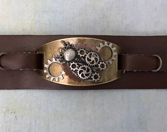 "Gears and Cogs Insect design Leather Cuff: snap enclosure 8 1/4"" l x 1 1/4 "" w"