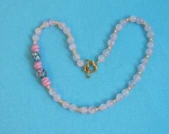 """Rose Quartz Gemstone Necklace with a Glass Floral Bead feature 18"""""""
