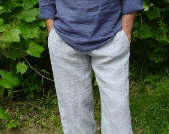 Men's linen trousers with pockets, rubber belt, and draw a twine.