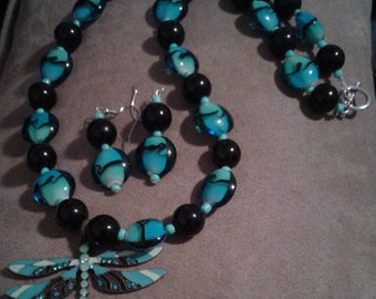 Turquoise blue black beads with dragon fly pendant