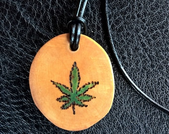 cannabis leaf design, hand made wooden pendant