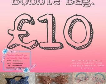 Bobble Bag, A bag full of Bobbles and clips, Bows on bobbles, pigtail bobble sets ponytail bobbles.