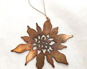 hand cut copper poinsettia Christmas ornament