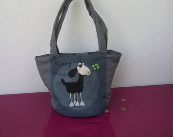 round basket in grey fabric and sheep pattern