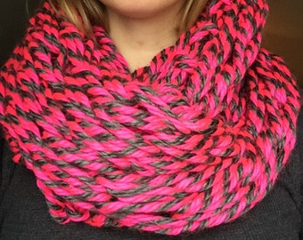 Hot pink and charcoal gray striped arm knitted scarf
