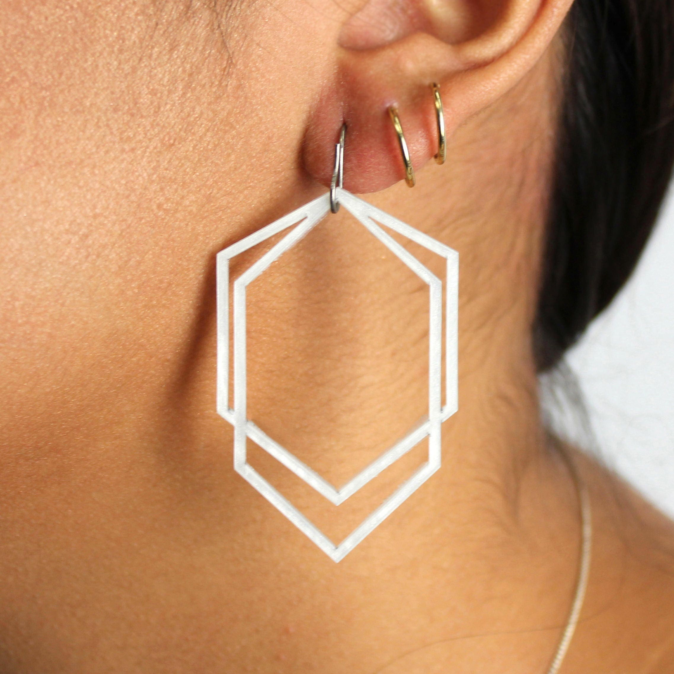 hexagon fawn and navy jesmonite earrings blue products rose stud