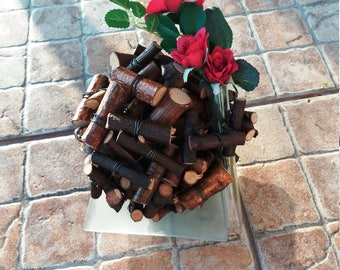 Decoration from birch twigs pieces, birch twigs ball, red plastic rose