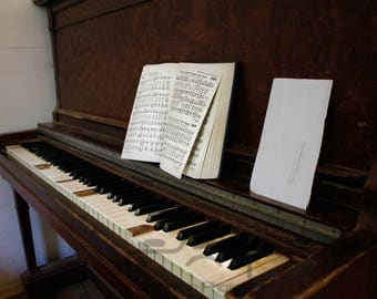 Old Upright Piano picture with opened church handbook