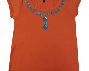 Peach short sleeved top with hand stitched blue beads