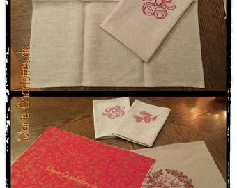 Embroidered fine linen napkins with Christmas motifs