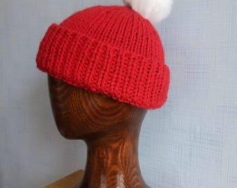Red Crismas. Woolen winter hat with pompon.