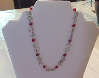 Silver toned necklace with red bead accents