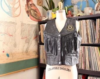 vintage fringe leather biker vest, APPRX mens medium, womens large, cropped black leather vest laced sides, toujours pret patch always ready