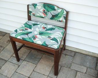 Vintage boudoir chair with clean lines and new seat fabric