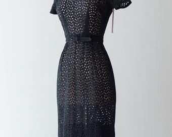 Vintage 1950s Dress - Black Cotton Eyelet Wiggle Dress w/ Matching Belt & Cute Collar Detail w/ Beveled Buttons by Dauphine // Waist 25