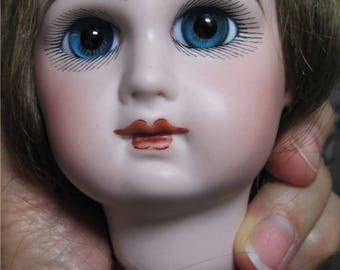 Reproduction Jumeau doll head with paperweight eyes